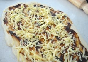 cheese and vegemite on top of dough