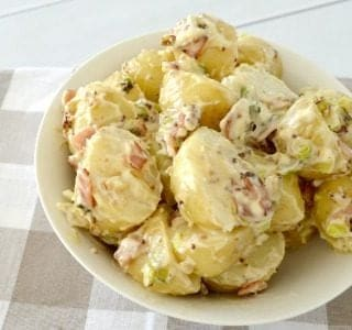close up of Potato Salad in a bowl on checked towel