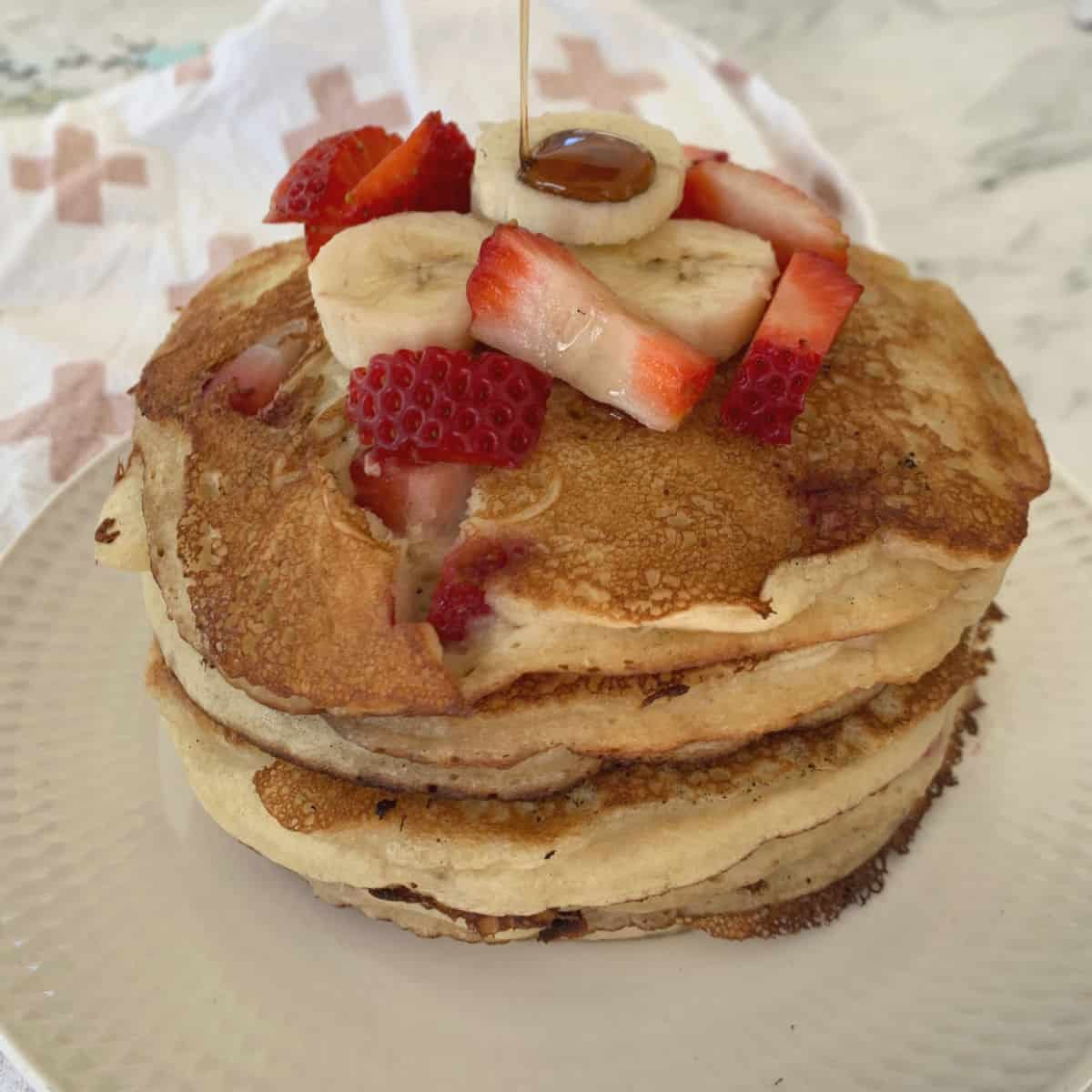 Stack of Strawberry and Banana Pancakes side view