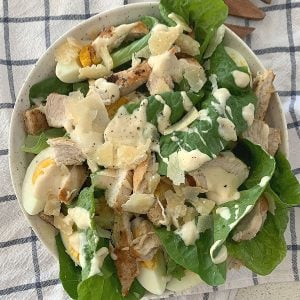 Chicken Caesar Salad in a bowl overhead