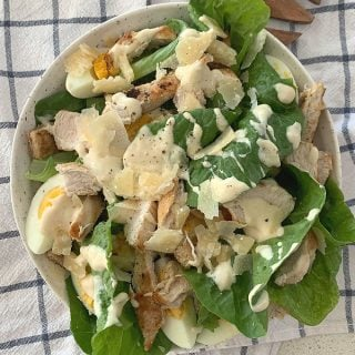 Chicken Caesar Salad in a bowl overhead