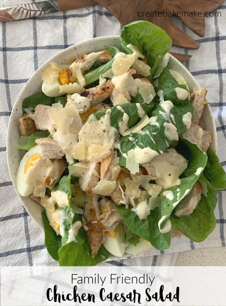 Overhead view of chicken caesar salad in a bowl