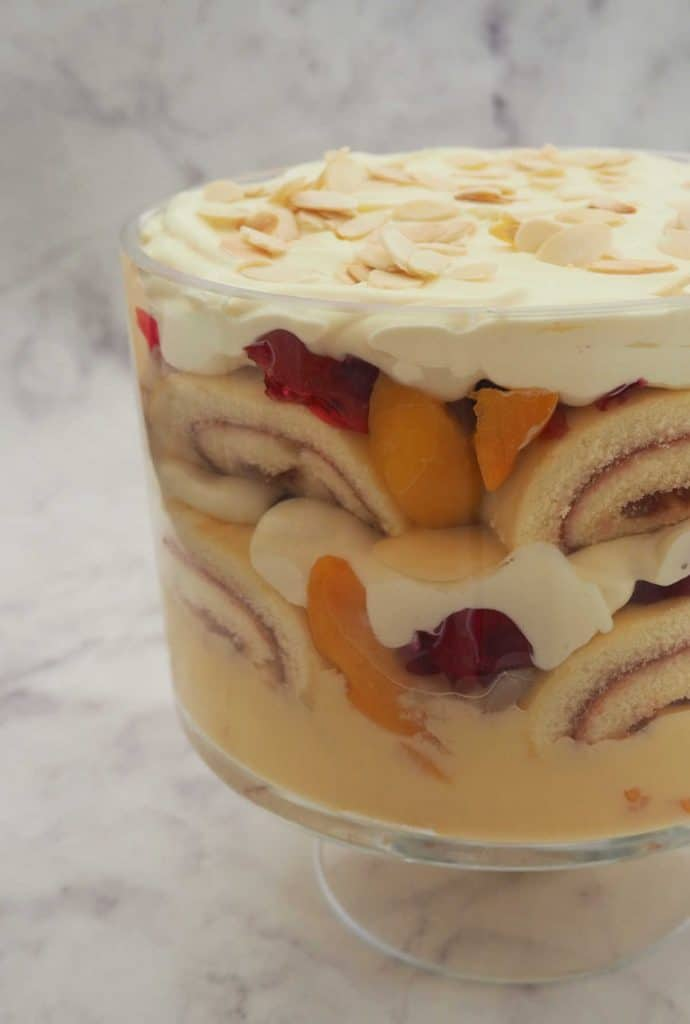 Trifle in a glass bowl on marble background