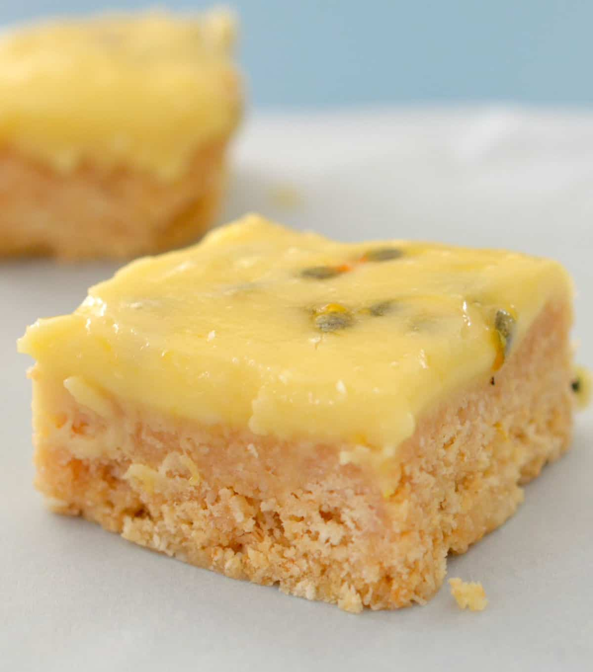 passionfruit slice on a piece of baking paper