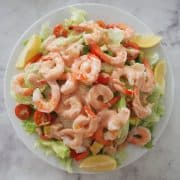 prawn salad overhead with lemon wedges