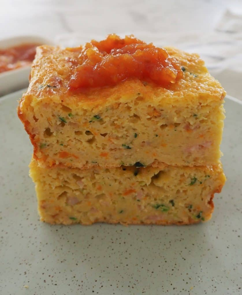 Side view of zucchini slice on a green plate