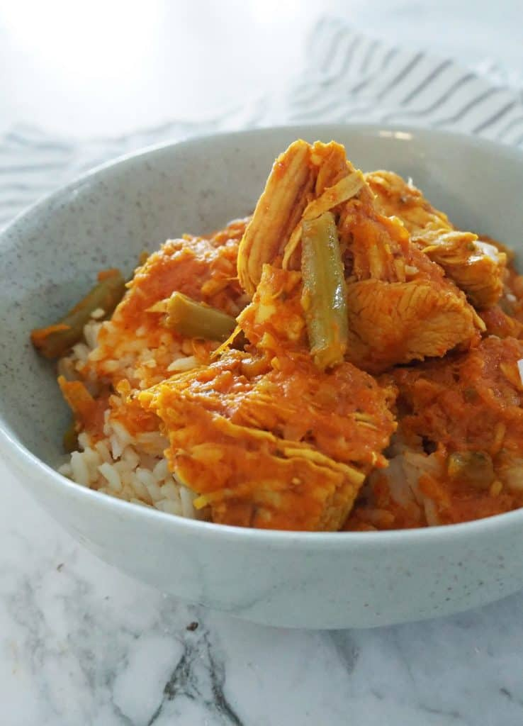 Chicken Curry in a green bowl side view