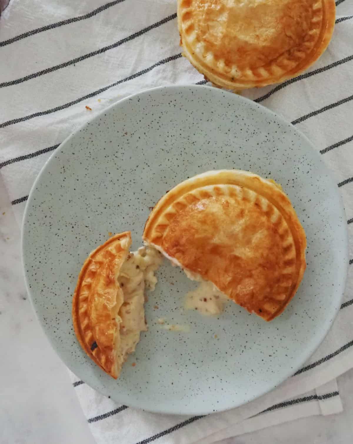 Pie cut in half on plate