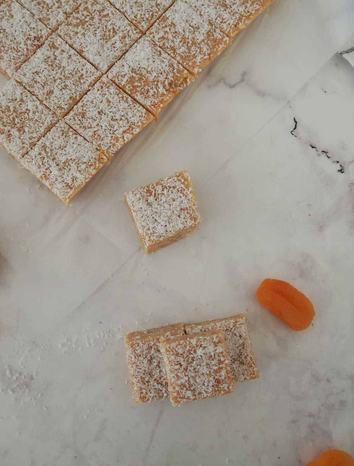 overhead view of apricot slice pieces on a marble background