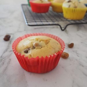 Raisin Muffin in red paper case on a marble background