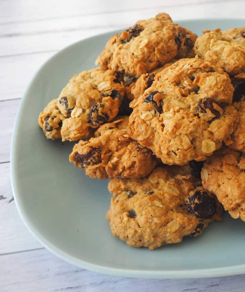 a blue plate with oatmeal raisin cookies on it
