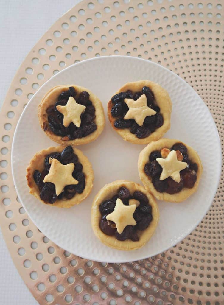 Fruit Mince Pies on a white plate with gold background